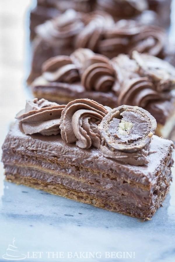 Ferrero Rocher Napoleon cake sliced into bars.