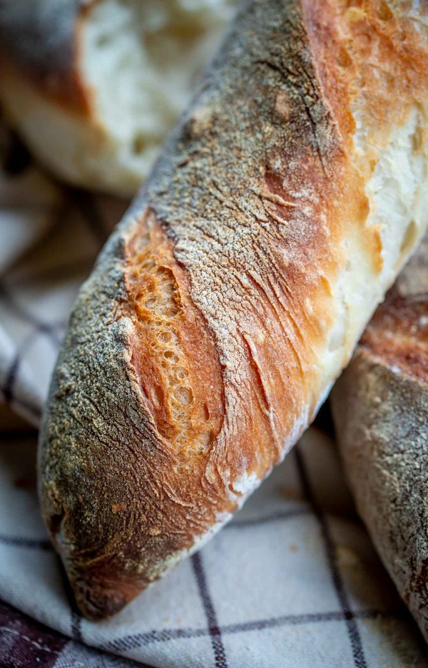 Baguette close up with floured and crisped up exterior.