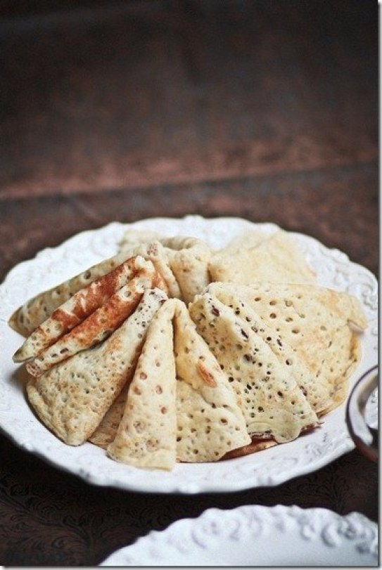 Russian Yeast Blinis - thick, slightly chewy with nice lacy appearance from the yeast in the batter. This recipe is a true Russian Blini recipe that is a nice treat for breakfast, snack or even dinner if you wish.