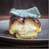 Classic Eclair filled with Custard and topped w/ Chocolate Glaze. by Let the Baking Begin!