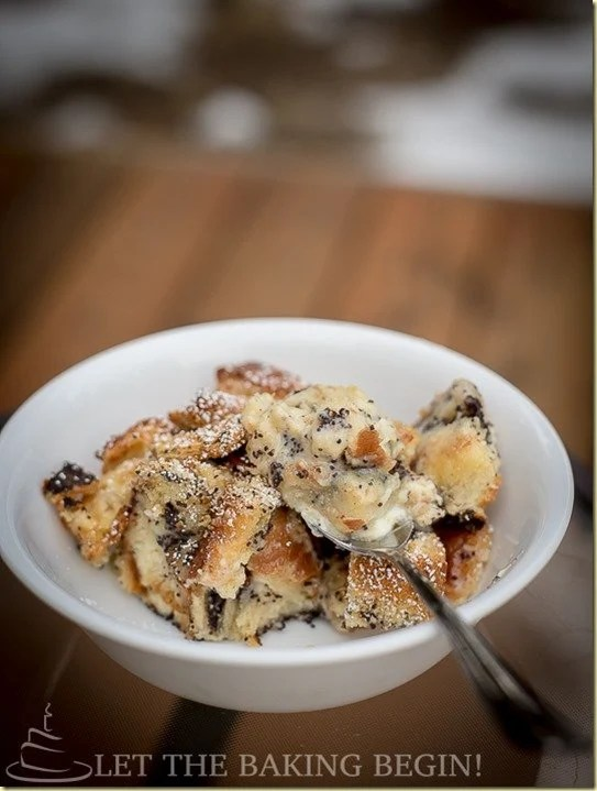 Baked French Toast with tons of poppyseeds, white and dark chocolate and condensed milk. This Breakfast Bake will have everyone begging for the recipe!