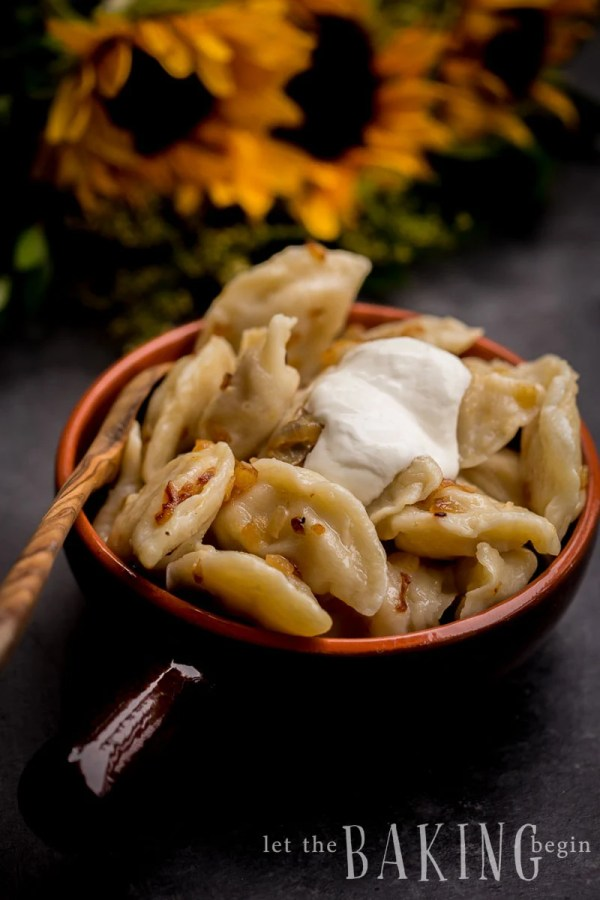 Potato Pierogi {Vareniki} are pasta pockets full of mashed potatoes and caramelized onions. Add some shredded cheese to the mixture if you wish, but they're awesome as is. These Potato Pierogies make a good make-ahead meal, since they freeze nicely and are ready to be cooked when you are. Comfort food at it's best!