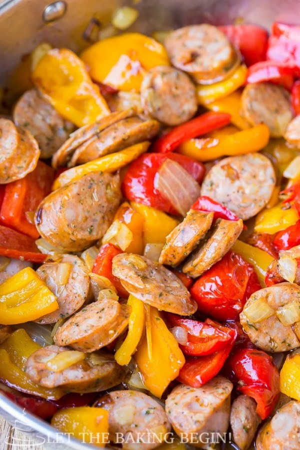 The sausage, peppers and onions are sauteed before the sauce is made in the same skillet and the pasta is added.