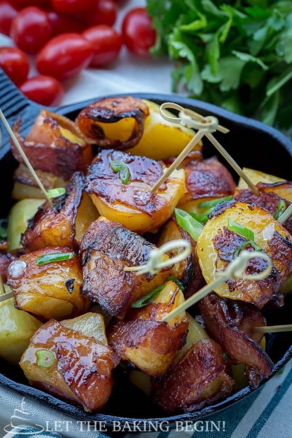 Bacon Wrapped Potatoes - Potato pieces, tossed in BBQ sauce and lovingly wrapped in smoked bacon, then roasted to crispy golden perfection. By LetTheBakingBeginBlog.com | @Letthebakingbgn