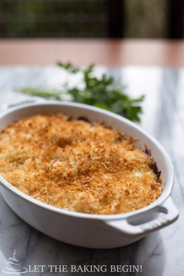 Cheesy Parmesan Crusted Salmon Bake in a casserole dish.