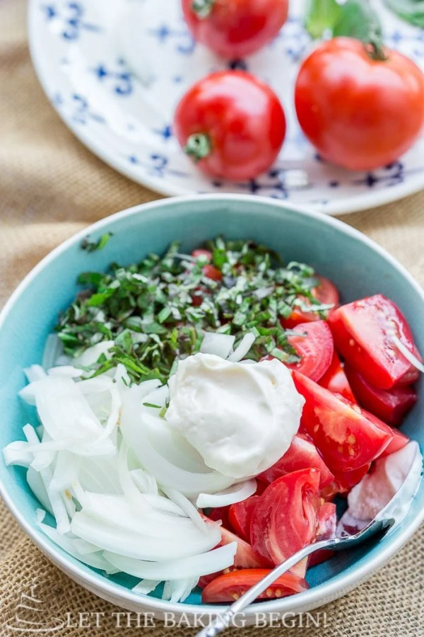 Creamy Tomato Salad is best made with fresh, heirloom tomatoes, loads of basil and sweet onion. This is the summer salad that you will be making, over and over again!
