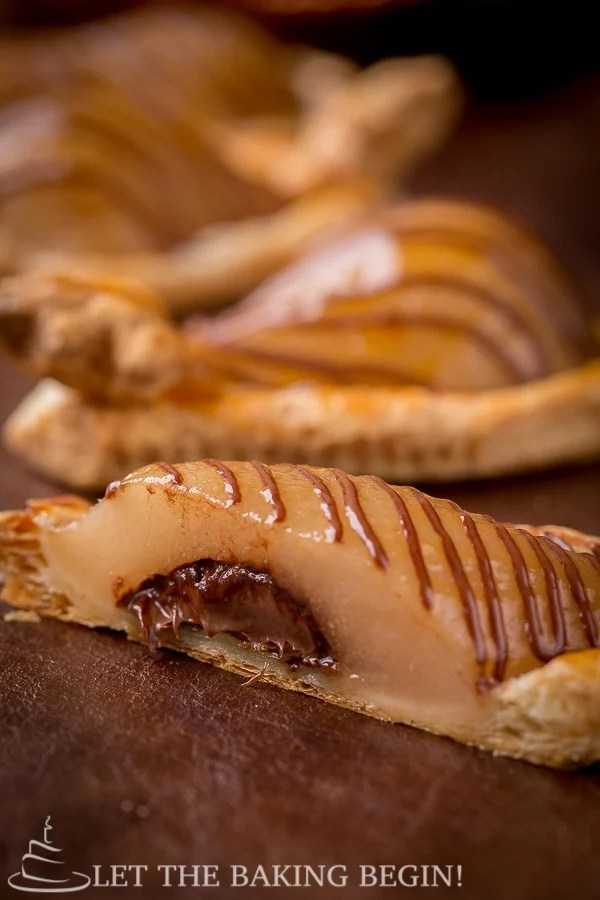 Cut pastry filled with Nutella and topped with a poached pear.