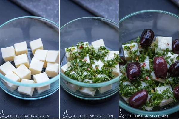 Marinated Cheese - combination of Darigold White Cheddar Cheese, garlic, parsley, olives and a splash of olive oil, served on a bed of baby rucola leaves. | @Letthebakingbgn