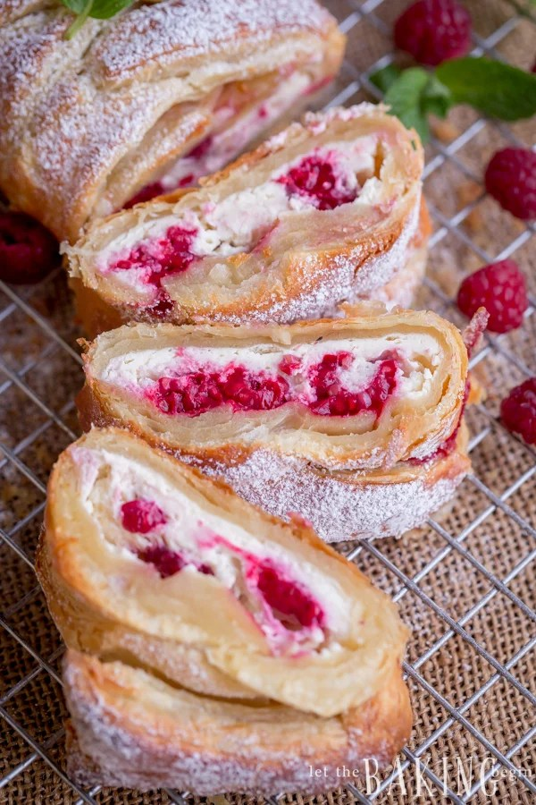 Raspberry Cheesecake Danish - Puff pastry braid filled with cheesecake and raspberries is impressive as it is easy to make. Follow the step by step picture instructions for a homemade dessert that take only 30 minutes to make! By Let the Baking Begin!
