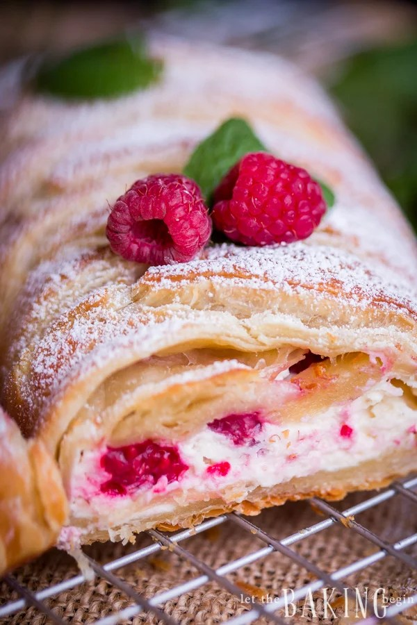 Puff pastry braid filled with cheesecake and raspberries is impressive as it is easy to make. Simple and delicious puff pastry recipe!