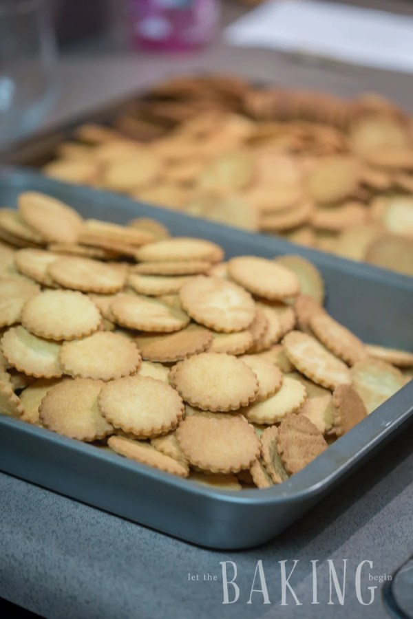 Shortbread cookie shells in a baking sheet.