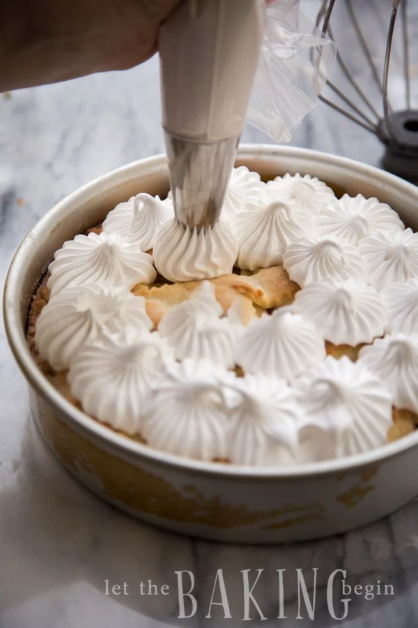 A pirog in a baking sheet topped with a basic meringue.