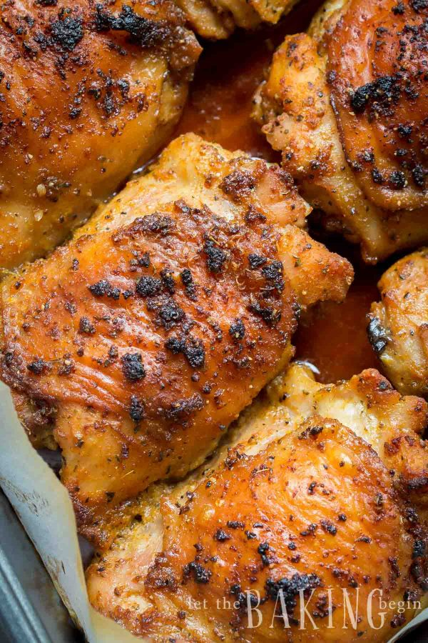 Garlic Ranch Baked Chicken Thighs are crispy on the outside and very tender on the inside. Just toss the chicken thighs with ranch seasoning and garlic, then bake! This recipe is our go to recipe for busy weeknight dinners.