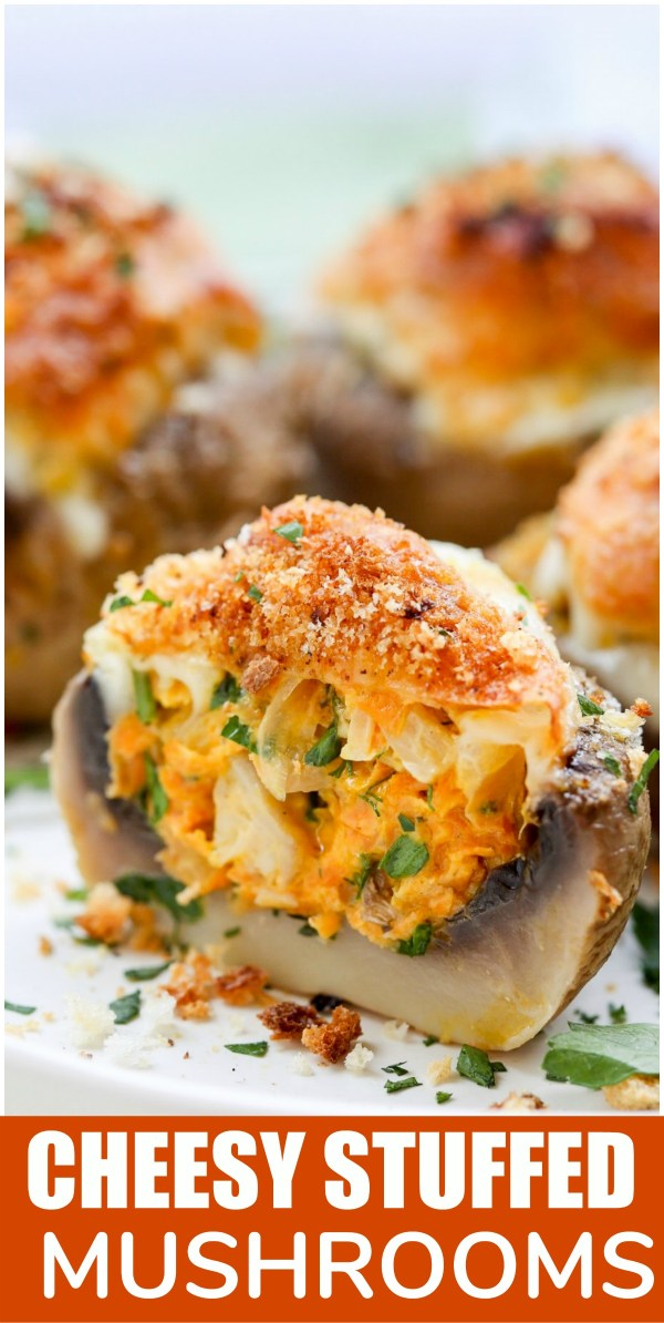 Cheesy stuffed mushrooms topped with fresh greens on a white tray.