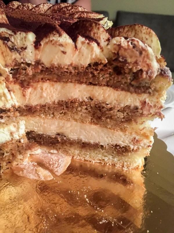 Tiramisu cake cut to see spongy inside.