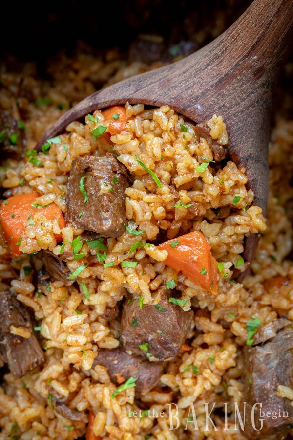 Close up of a spoonful with Beef Rice Plov (rice, beef, carrots).