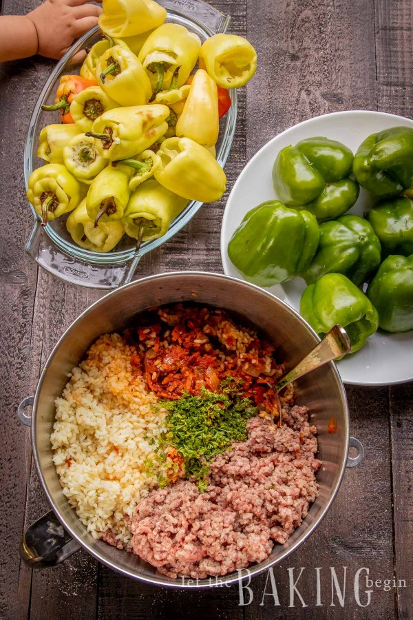 Stuffed Baby Peppers with Beef Rice are my kids favorite Stuffed Peppers Recipe. They are filled with flavorful mixture of fluffy rice and delicious beef, then oven cooked until tender perfection. Top with cheese for melty perfection or sour cream for extra creaminess.