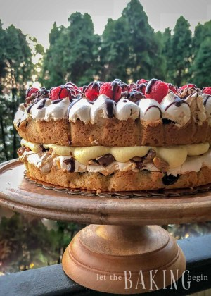 This Polish Cake is a combination of soft shortbread cake layers, tart jam, crunchy meringue, roasted walnuts and sandwiched with buttercream custard.