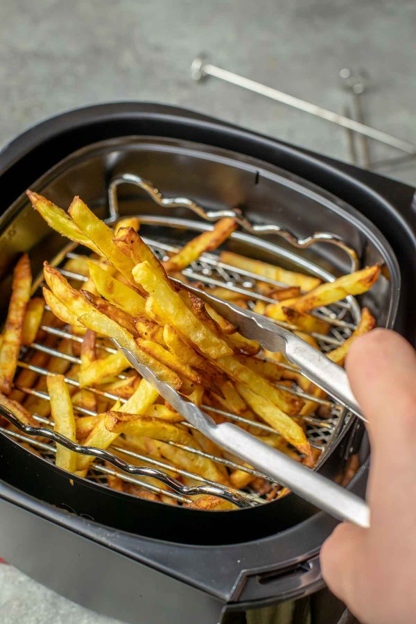 Air fryer French Fries are the deep fried french fries' healthy cousins. The potatoes are cooked with just a tiny amount of oil but still have a ton of flavor and crispiness.