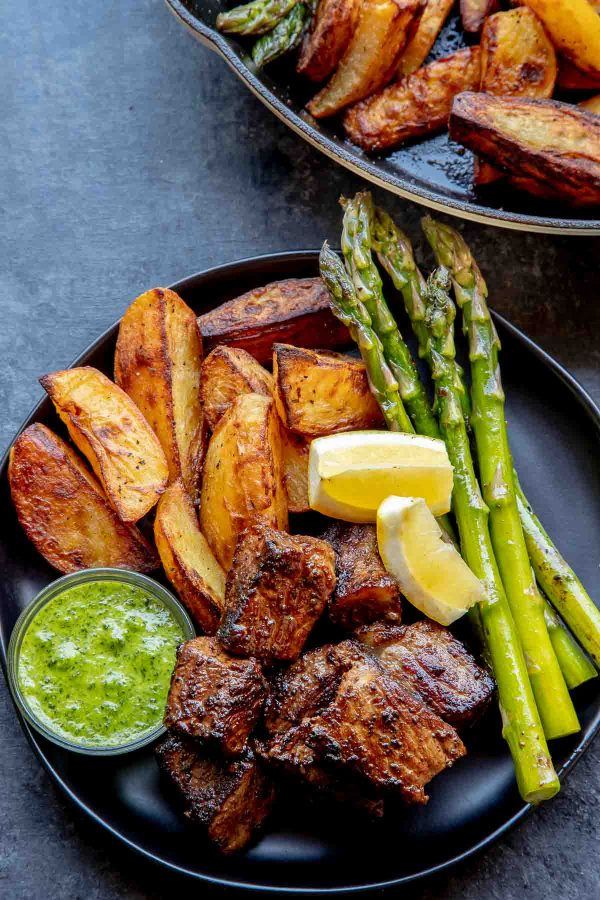 Roasted Yukon Gold Potatoes with steak bites and asparagus.