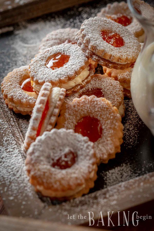 Shortbread cookies with jam dusted with powdered sugar
