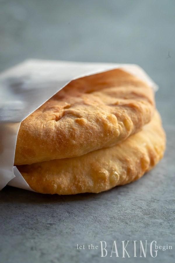 2 Freshly baked piroshki wrapped in paper