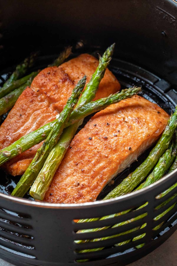 Air Fried salmon fillets in the air fryer with spears or asparagus.