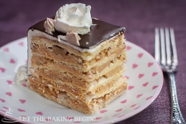 The most popular and most often requested cake in our family. Markiza cake consists of thin shortbread cake layers, topped with meringue & walnuts, then layered with dulce de leche filling. by Let the Baking Begin!