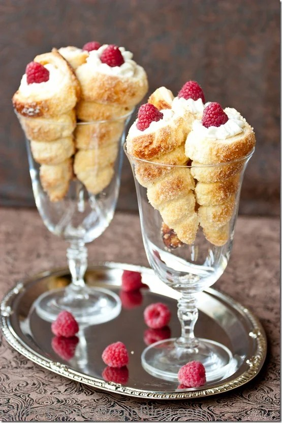 Puff Pastry Cream Horns with Luscious White Cream and Raspberries