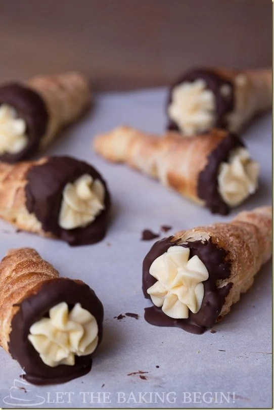Crispy Cream Horns filled with Condensed Milk Custard and dipped in Chocolate by LettheBakingBeginBlog.com
