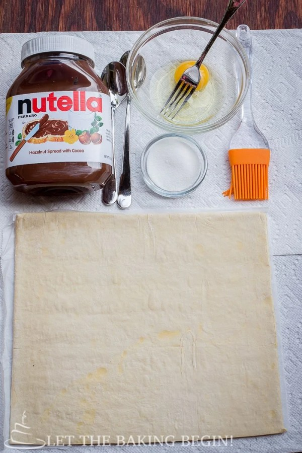 Nutella Puff Pastry Danish - 10 minutes of your time and you can be enjoying these ridiculously delicious danishes as well! Check out the step by step photo tutorial! @Letthebakingbgn |   LetTheBakingBeginBlog.com