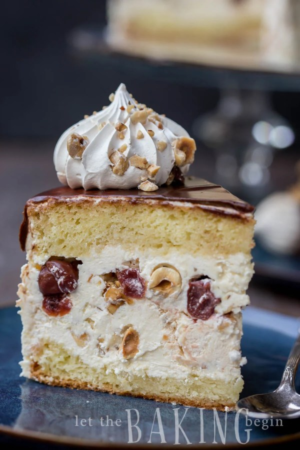Kiev Cake - Yellow Sponge Cake combined with Hazelnut Meringue, Russian Buttercream and Tart Cherries. A very loose but incredibly delicious interpretation of a classic Ukrainian Cake   By Let the Baking Begin!