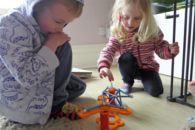 children playing with geomag mechanics set