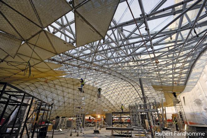 The structure of the floating golden roof of the Louvre's Islamic Art Department...