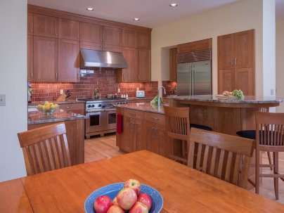 Contemporary Portland kitchen with wood cabinets and brick backsplash
