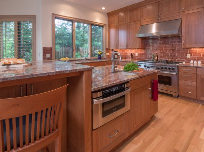 Contemporary Portland kitchen with wood floors and granite countertops