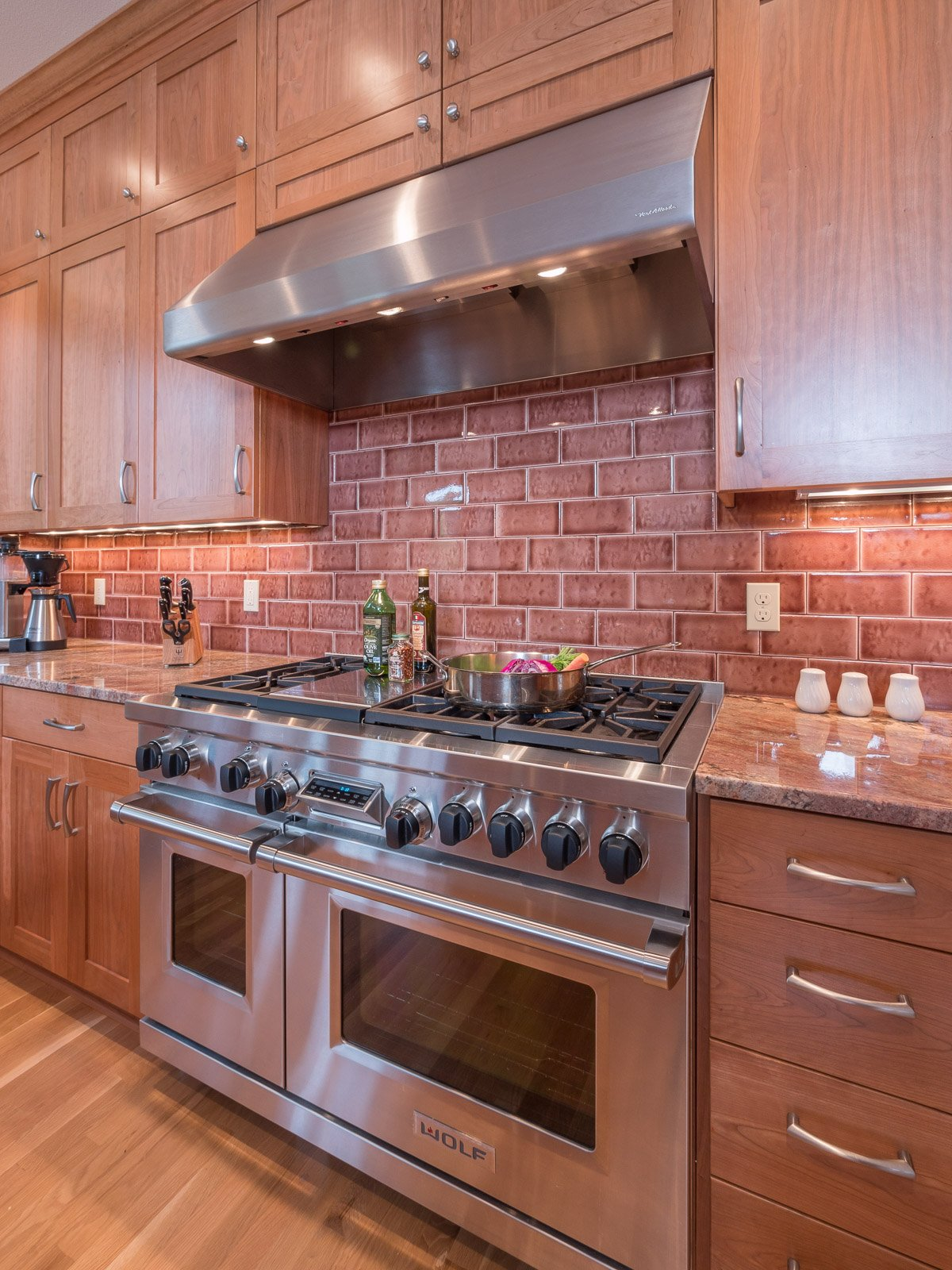 Contemporary Portland kitchen with stainless steel oven and brick backsplash