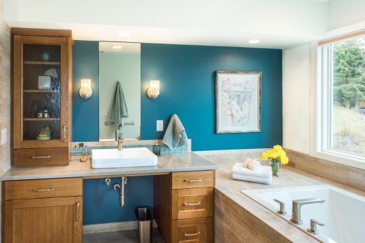 Warm meets contemporary in this bathroom remodel featuring reclaimed wood.