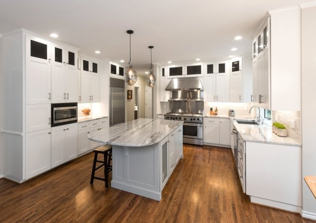 White kitchen with white cabinets and countertop and island