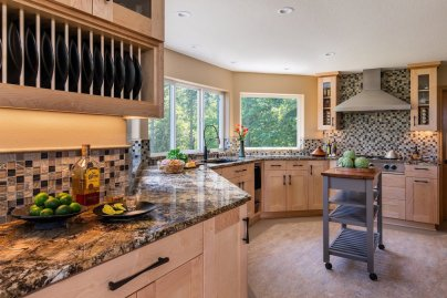 Black and Tan Kitchen with Checkered Tile Backsplash