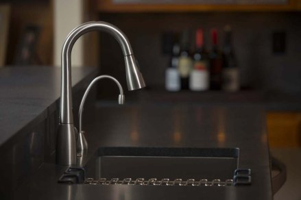 dark slate countertop with stainless steel faucet