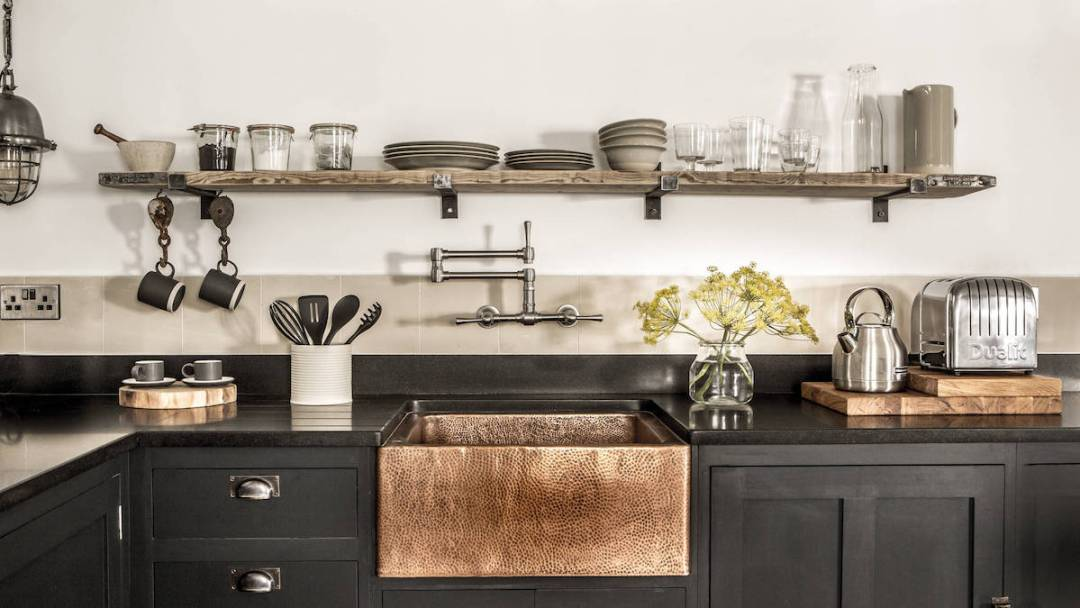 Statement Sink with Copper sink and dark gray countertop