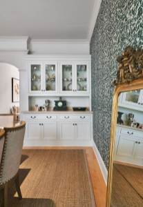 luxury dining room with beautiful wall paper and antique mirror