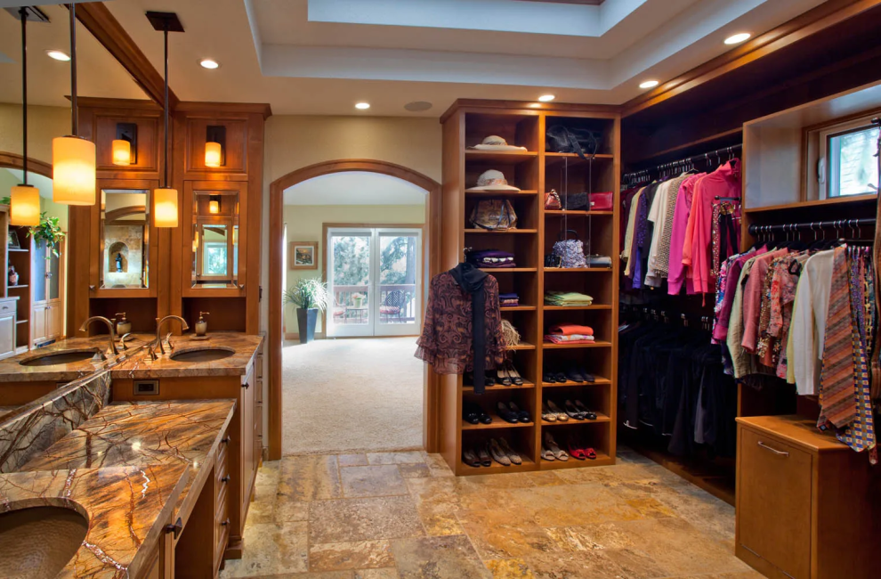 master bath with large walk-in closet and pretty marble flooring