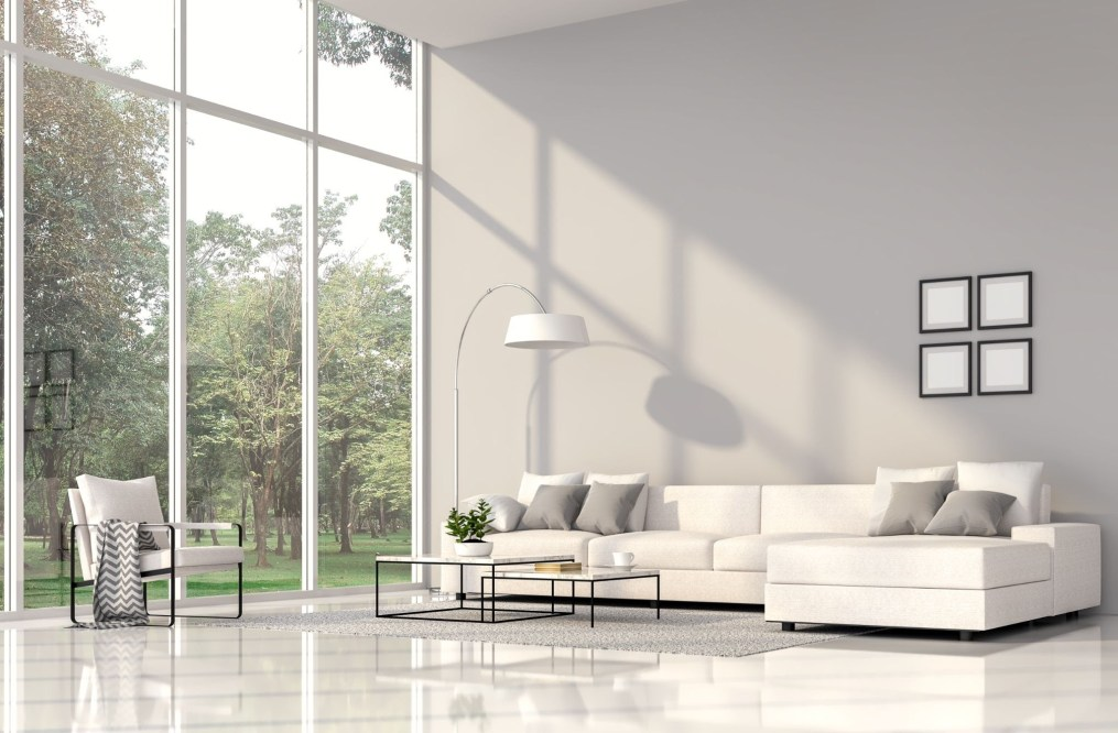 white grey modern living room with large glass windows and natural light