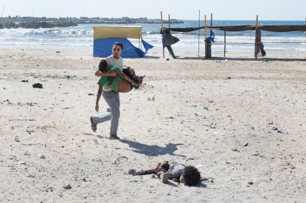 boys fleeing gaza attack - aftermath