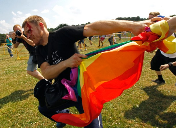An anti-gay protester clashes with gay rights activists during a Gay Pride event in St. Petersburg