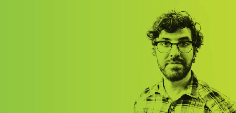 man in green background