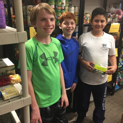 Level Up's 6th Grade Boys team organize food for Shelter Inc