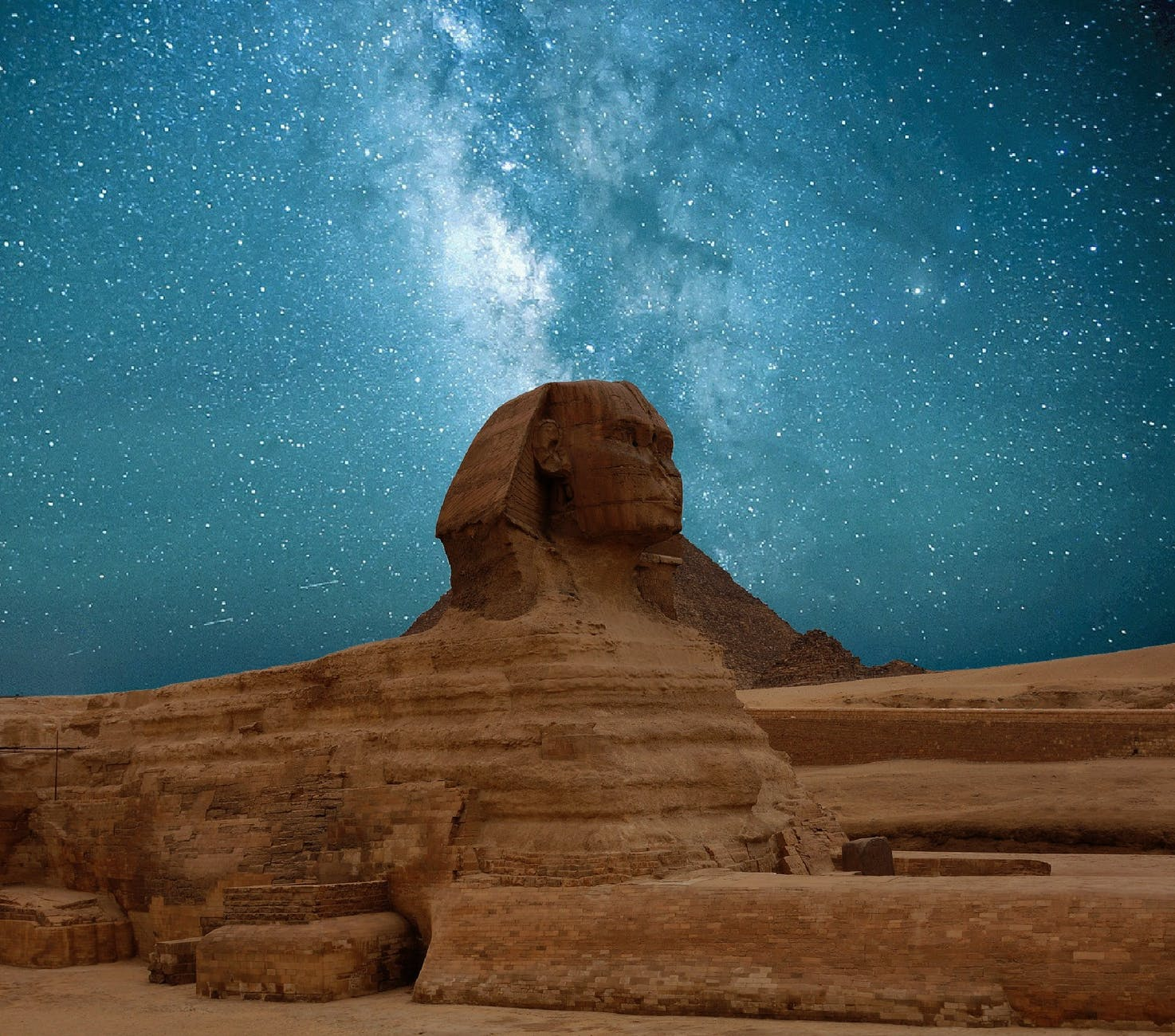 great sphinx of giza under blue starry sky